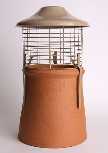 Euro Topguard 2 Birdguard on a chimney pot, cotswold stone