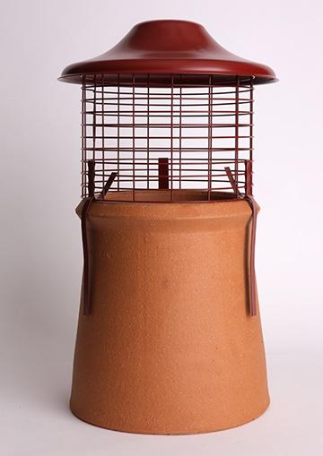 Euro Topguard 2 Birdguard on a chimney pot, terracotta